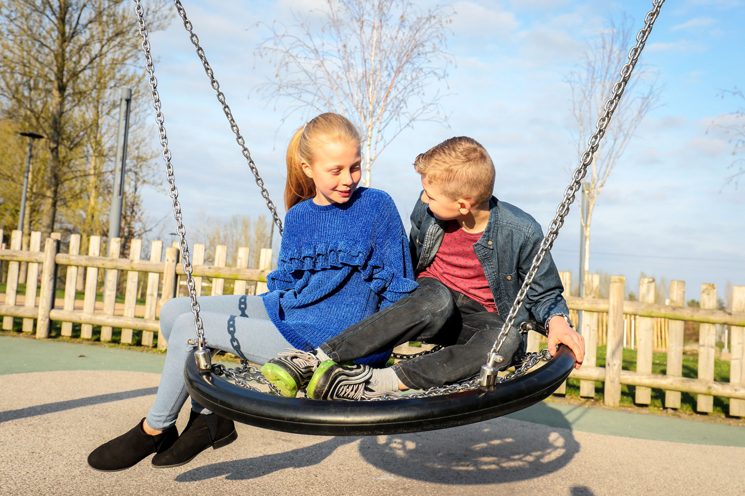Picture of two children on a nest swing in Telford Town Park