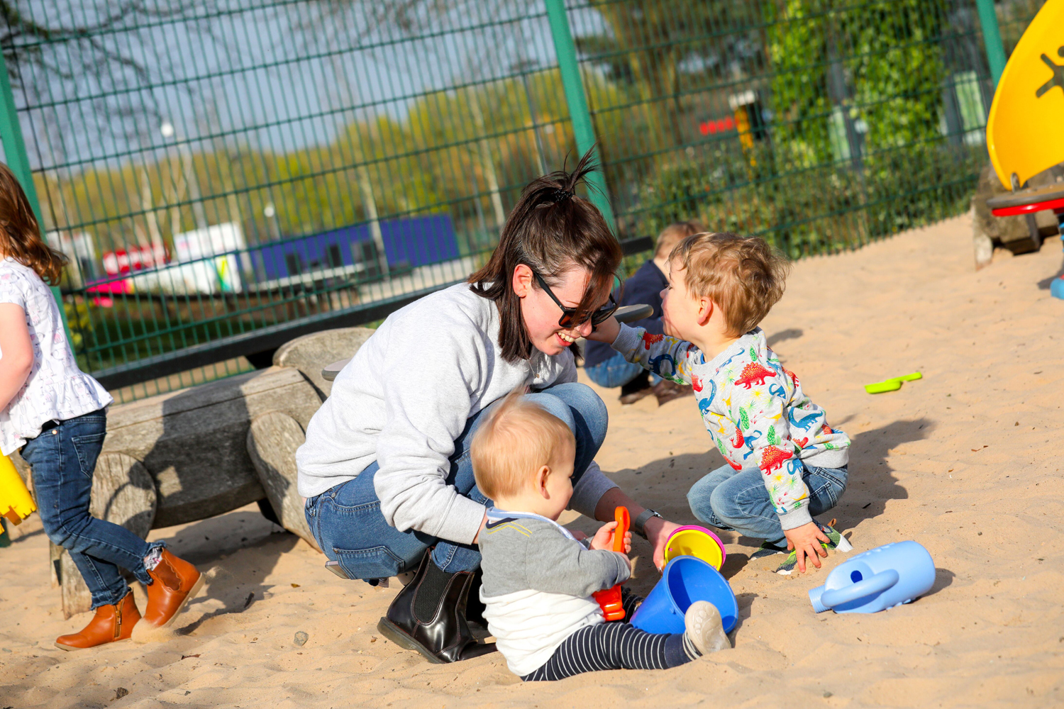 Illustration of a family playing in the sand pit at Telford Town Park