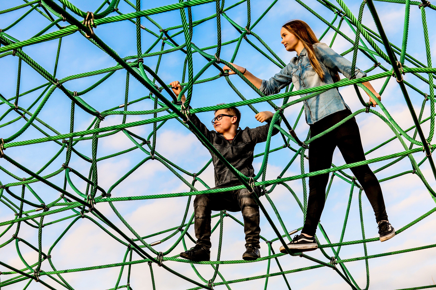 Illustration of two children climbing on the spiders web at Telford Town Park