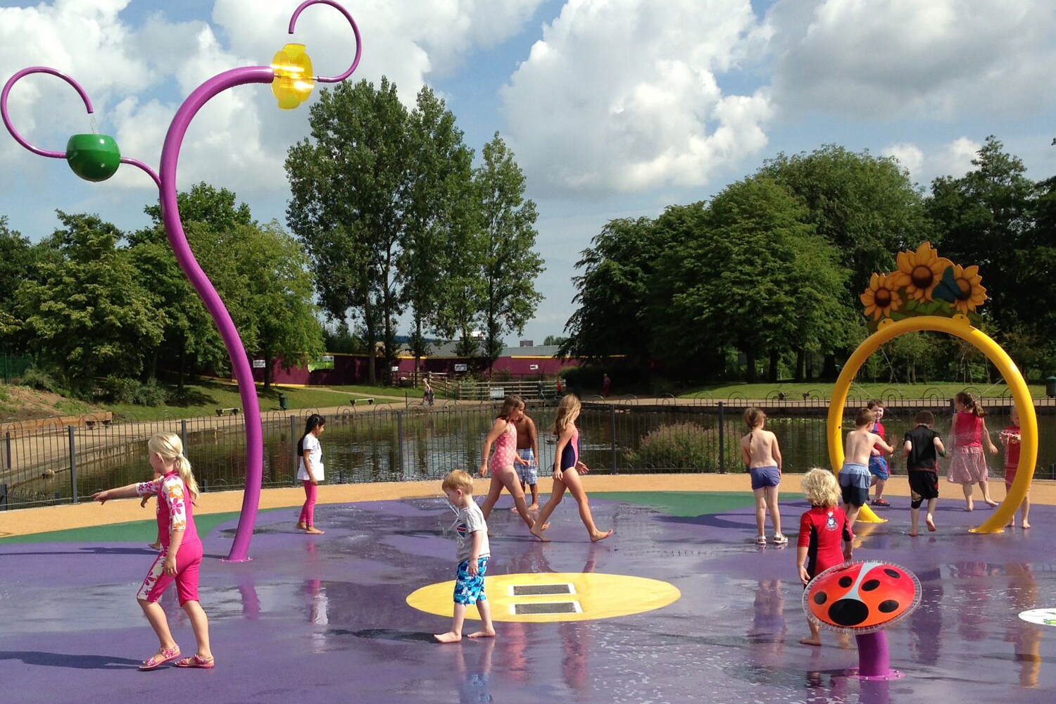 Illustration of children playing in the water play area at Telford Town Park